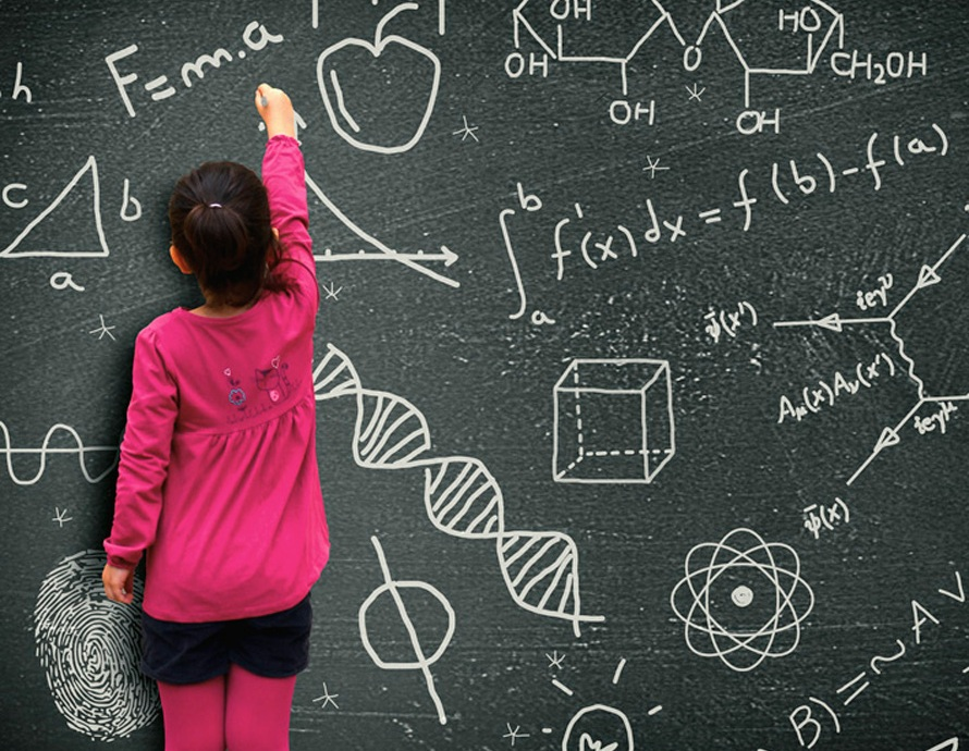 Little girl writing on blackboard - Learning and knowledge concept